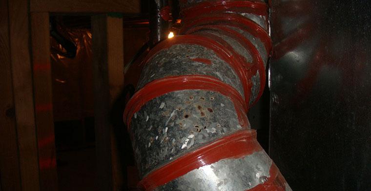 Corroded flue releasing carbon monoxide