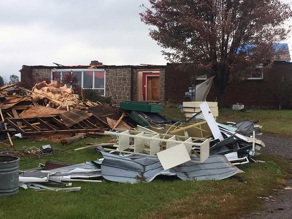 Inspection on a bungalow that was struck by a tornado.